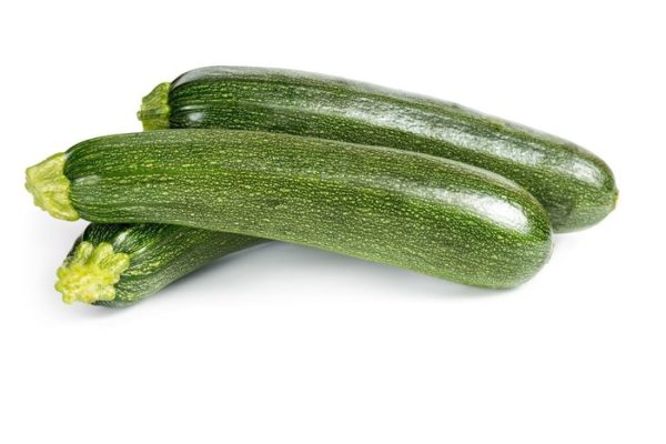 20262533 – three ripe zucchini isolated on a white background